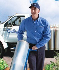 Man working for Culligan Water bringing in saltless water softener system.